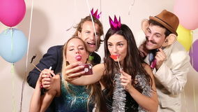 Group of happy friends taking selfie in photo booth stock video footage
