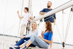 Group of happy friends traveling on a yacht. And drinking champagne. Tourism, vacation, holiday, concept stock image