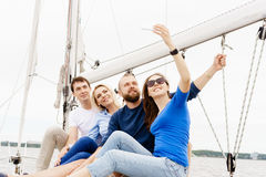 Group of happy friends traveling on a yacht and taking selfie. T. Ourism, vacation, holiday, concept stock photos