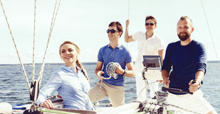 Group of happy friends traveling on a yacht. Tourism, vacation,. Group of friends traveling on a yacht and enjoying a good summer day. Vacation, holiday royalty free stock photos