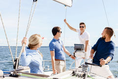 Group of happy friends traveling on a yacht. Tourism, vacation,. Holiday, concept royalty free stock photography