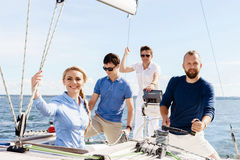 Group of happy friends traveling on a yacht. Tourism, vacation,. Holiday, concept stock photo