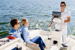 Group of happy friends traveling on a yacht. Tourism, vacation,. Holiday, concept stock images