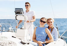 Group of happy friends traveling on a yacht. Tourism, vacation, Stock Images