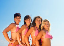 Group of happy girls in bikinis Stock Images