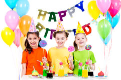 Group of happy girls with colorful candies. Royalty Free Stock Image
