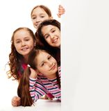 Group of girls behind advertising board Royalty Free Stock Photography