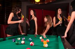 Group of happy girls playing in billiard. Group beautiful of happy girls playing in billiard Stock Photo