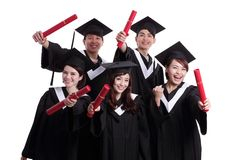 Group of happy graduates student Stock Images