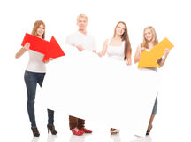 Group of happy and happy teenagers holding arrows. Group of happy teenagers holding arrows on a white billboard background Royalty Free Stock Photo
