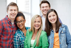 Group of happy high school students or classmates Stock Image
