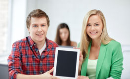 Group of happy high school students with tablet pc Royalty Free Stock Image