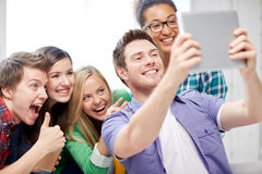 Group of happy high school students with tablet pc Stock Photos