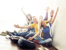 Group of happy hipster students on a break. Teenagers waving hands.Group of happy hipster students on a break. Teenagers waving ha. Group of happy hipster Stock Images