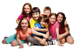 Group of happy hugging kids. Laughing and smiling together in big group Stock Image