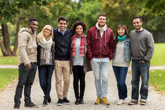 Group of happy international friends at park Stock Images