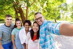 Group of happy international friends taking selfie Royalty Free Stock Image