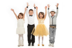Group of happy kids in celebratory clothes. Isolated on white background. Holidays, christmas, new year, x-mas concept Royalty Free Stock Images