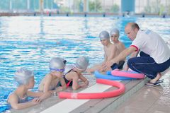 Group of happy kids children at swimming pool Stock Photography