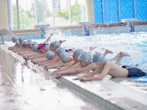 Group of happy kids children at swimming pool Stock Photos