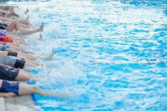 Group of happy kids children at swimming pool Stock Photo