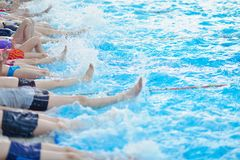 Group of happy kids children at swimming pool Stock Image