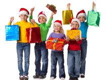 Group of happy kids with christmas gifts Royalty Free Stock Photo