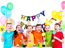 Group of happy kids with colorful candies. Stock Photos