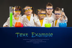 Group happy kids doing science experiments in the laboratory. Royalty Free Stock Photo