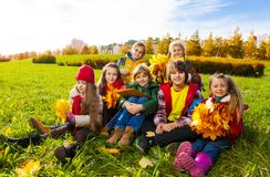 Group of happy kids on the grass royalty free stock photos