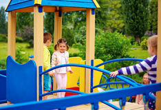 Group of happy kids having fun on playground Royalty Free Stock Photo