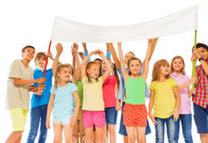 Group of happy kids hold empty white banner royalty free stock photo