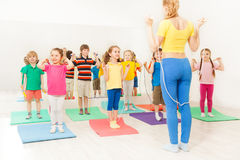 Group of happy kids jumping ropes at gym lesson Royalty Free Stock Photo
