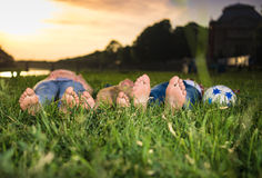 Group of happy kids lying on the grass Royalty Free Stock Photo