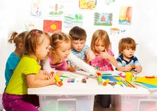 Group of happy kids painting and Royalty Free Stock Photo