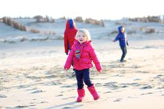 Group of happy kids playing on the beach Royalty Free Stock Images