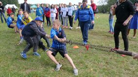 Group of happy kids pulls rope having tug of war in park, recreation outdoors. Oleshky, Ukraine 1 October 2017: group of happy kids pulls rope having tug of war stock video