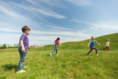 Group of happy kids running outdoors Royalty Free Stock Photos