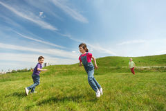 Group of happy kids running outdoors Royalty Free Stock Photography