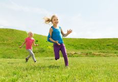 Group of happy kids running outdoors Stock Photo