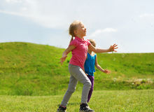 Group of happy kids running outdoors Stock Photography