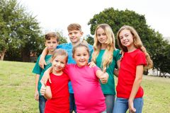 Group of happy kids showing thumbs up Royalty Free Stock Images