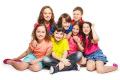 Group of happy kids sitting together Royalty Free Stock Image