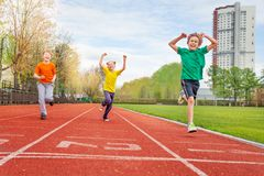 Group of happy kids on stadium Royalty Free Stock Photography