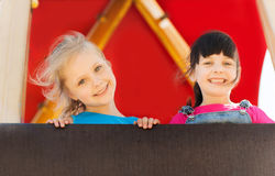 Group of happy little girls on children playground Stock Photography