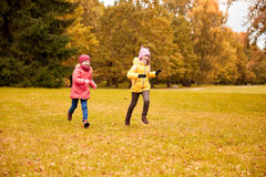 Group of happy little girls running outdoors Stock Photography