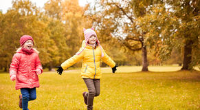 Group of happy little girls running outdoors Stock Images
