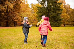 Group of happy little kids having fun outdoors Royalty Free Stock Image