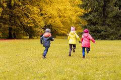 Group of happy little kids running outdoors Royalty Free Stock Photography