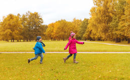 Group of happy little kids running outdoors Stock Image